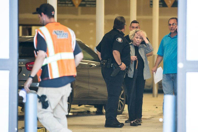 Yakima Mayor Kathy Coffey walks out of her vehicle after driving into a Rite Aid building in Yakima on Friday. (Amanda Ray / Yakima Herald-Republic)