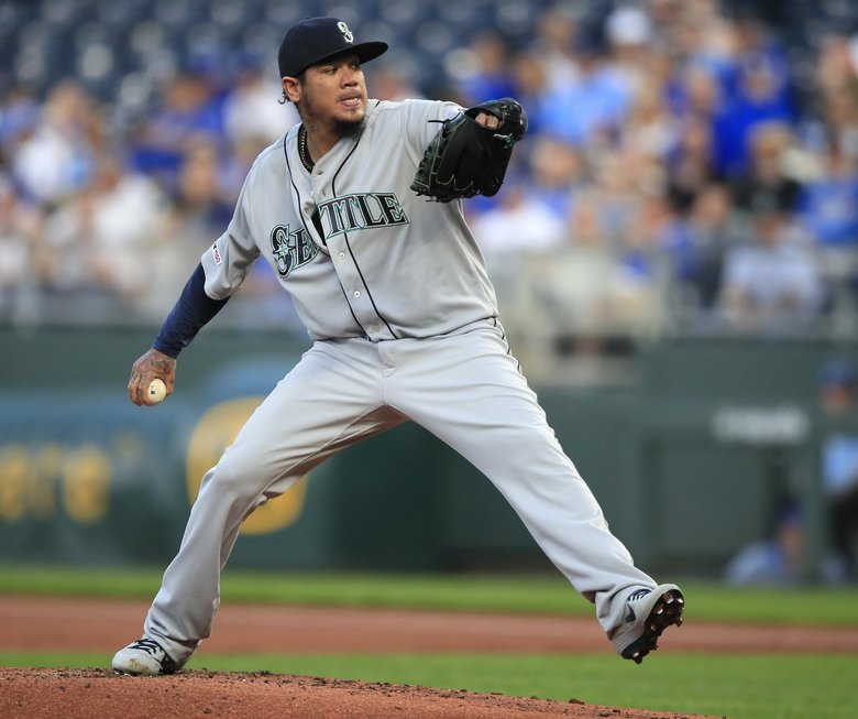 Mariners starting pitcher Felix Hernandez throws in the first inning Monday at Kauffman Stadium in Kansas City. (Orlin Wagner / The Associated Press)