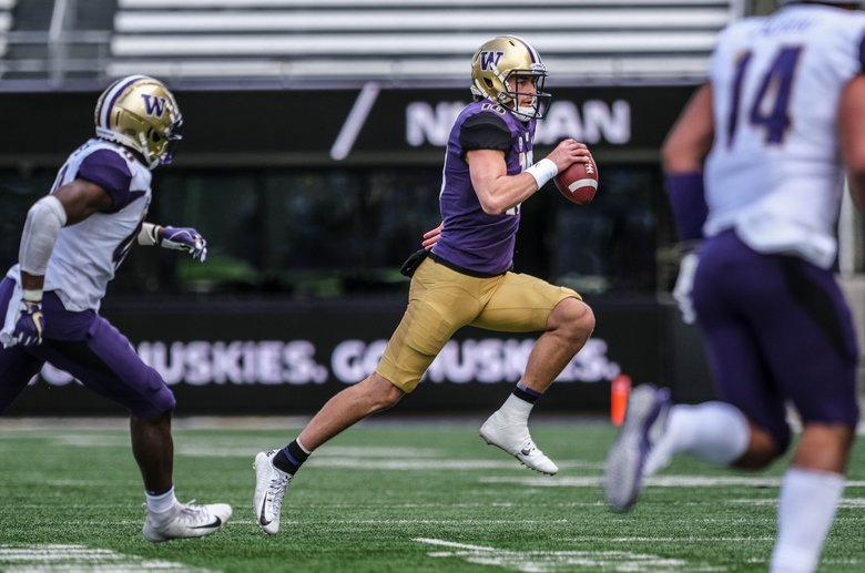 Quarterback Jacob Eason is flushed out of the pocket and headed to the sidelines.  Washington held its 2019 Husky Spring Football Preview at Husky Stadium Saturday, April 27, 2019. (Dean Rutz / The Seattle Times)
