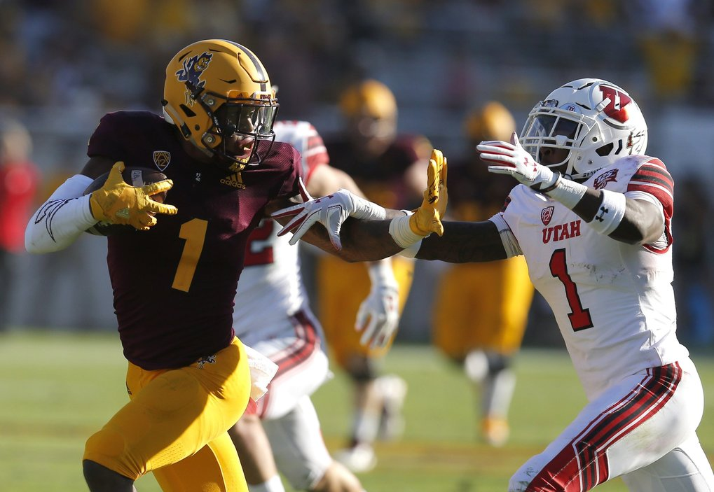 Arizona State wide receiver N'Keal Harry fends off Utah defensive back Jaylon Johnson in November. (Rick Scuteri / AP)