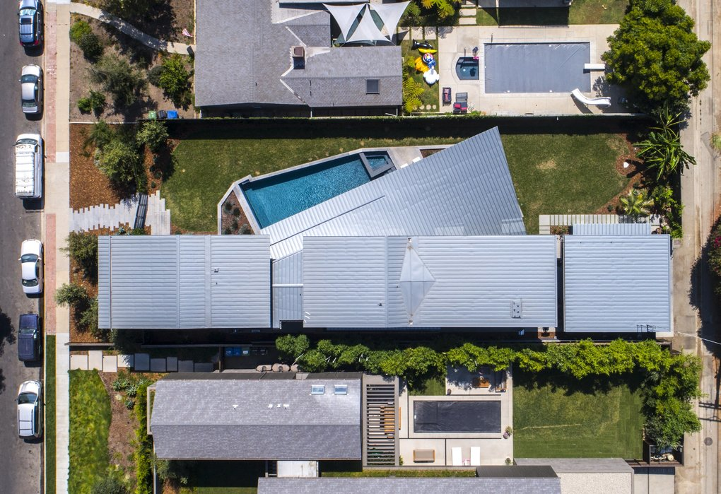 """""""We saw an opportunity to capture the dimension of the house from front to back in a way that is unusual, even in 'the Big Lot area' of Venice,"""" says architect Nils Finne. The bulk of The Venice House, then, """"has been placed on the eastern side of the 173-foot-long lot, making a linear, variegated garden on the western side. We designed the house so you could be the entire depth of the lot."""" Andy and Tannaz's sons are especially appreciative. """"They are boys. They've done laps,"""" Tannaz says. (Courtesy Tom Bonner Photography )"""