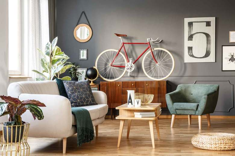 Scaled-down furniture that can serve multiple purposes, as well as using vertical space, are helpful when decorating a small home. (Getty Images)