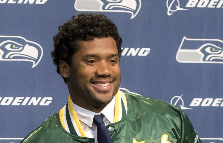 Seahawks quarterback Russell Wilson donned a Sonics jacket for a family photo with his wife Ciara, daughter Sienna Princess Wilson and stepson Future Zahir Wilburn after a press conference at the Virginia Mason Athletic Center Wednesday, April 17, 2019. Earlier this week, Wilson and the Seahawks agreed to a four-year, $140 million contract extension and $65 million signing bonus. The deal keeps him with the Seahawks through the 2023 season and makes him the highest-paid player in the history of the NFL.  209957