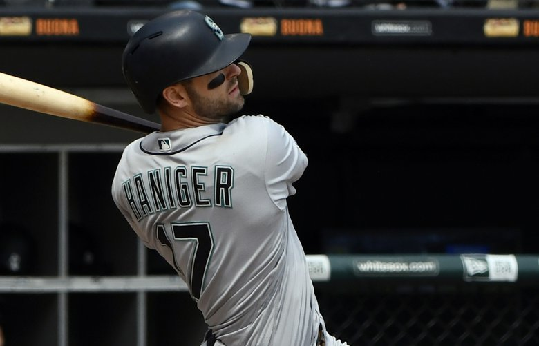 Seattle Mariners' Mitch Haniger (17) hits an RBI double against the Chicago White Sox during the third inning of a baseball game in Chicago, Saturday, April 6, 2019. (AP Photo/Matt Marton) CXS105 CXS105