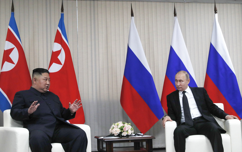 Russian President Vladimir Putin, right, and North Korea's leader Kim Jong Un talk during their meeting in Vladivostok, Russia, Thursday, April 25, 2019. North Korean leader Kim managed to match Russian President Vladimir Putin's manspreading – the two sat with knees spread wide apart as they chatted before the start of their first summit, which began Thursday in the far eastern port city of Vladivostok.(Sergei Ilnitsky/Pool Photo via AP)