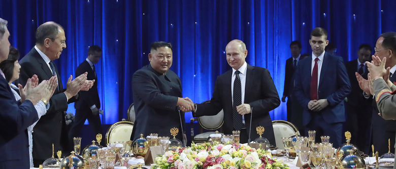 In this Thursday, April 25, 2019, photo provided by the North Korean government, North Korean leader Kim Jong Un, center left, shakes hands with Russian President Vladimir Putin in Vladivostok, Russia. The content of this image is as provided and cannot be independently verified. (Korean Central News Agency/Korea News Service via AP)