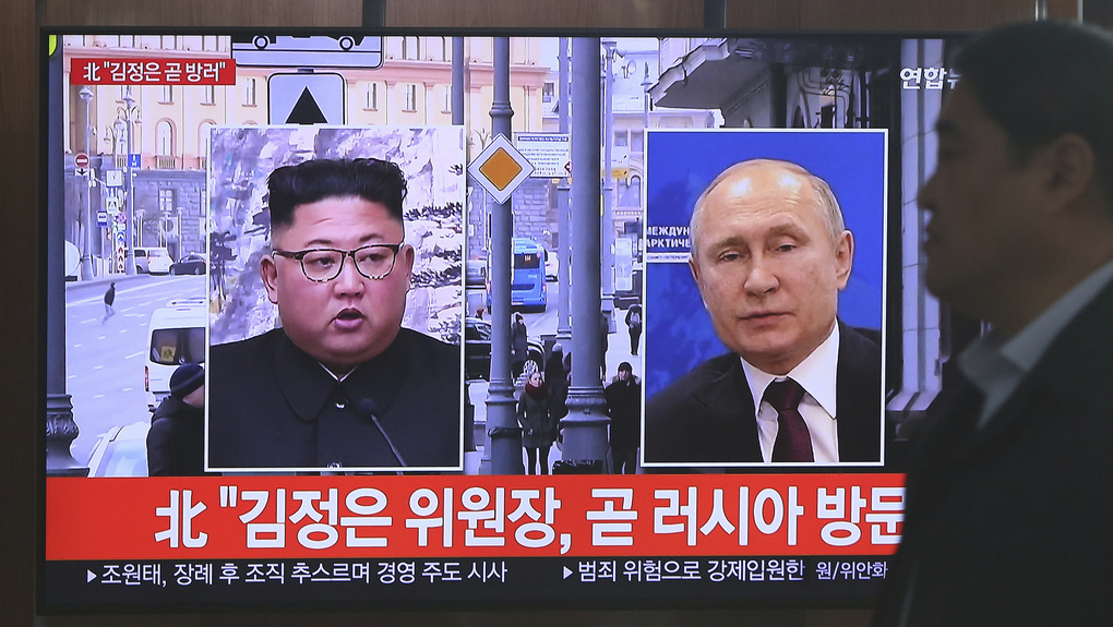 "A man passes by a TV screen showing images of North Korean leader Kim Jong Un, left, and Russian President Vladimir Putin, right, during a news program at the Seoul Railway Station in Seoul, South Korea, on Tuesday, April 23, 2019. North Korea confirmed on Tuesday that Kim will soon visit Russia to meet with Putin in a summit that comes at a crucial moment for tenuous diplomacy meant to rid the North of its nuclear arsenal. The screen reads: ""Kim Jong Un visits Russia soon"". — Photograph: Ahn Young-joon/Associated Press."