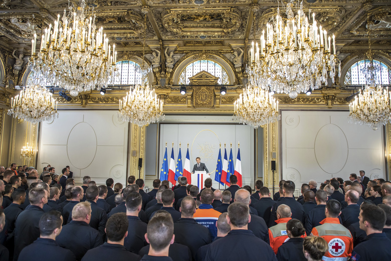 French President Emmanuel Macron addresses Paris Firefighters' brigade and security forces who took part to the fire extinguishing operations of the Notre Dame of Paris Cathedral, at the Elysee Palace in Paris, Thursday, April 18, 2019. France paid a daylong tribute Thursday to the Paris firefighters who saved the internationally revered Notre Dame Cathedral from collapse and rescued many of its treasures.(Christophe Petit Tesson, Pool via AP)