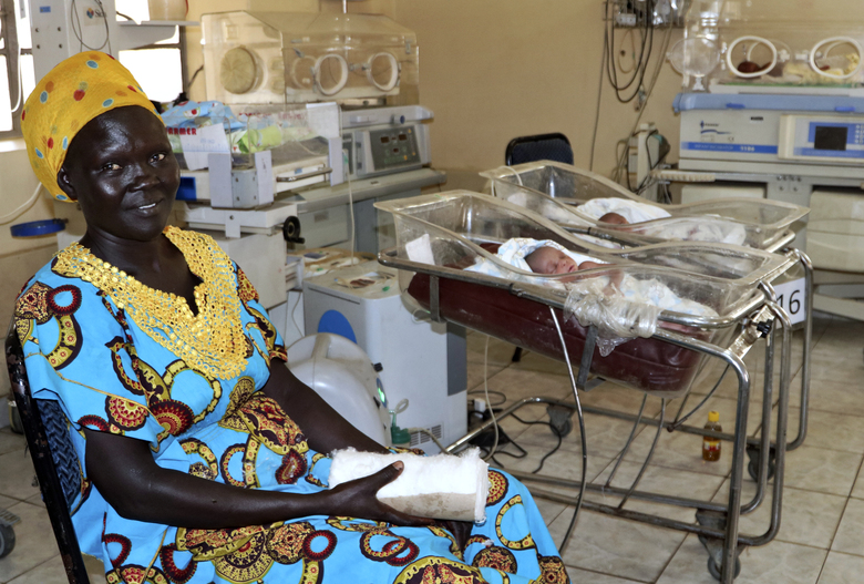 In this photo taken Monday, March 11, 2019, a mother sits beside her newborn in the ward for premature babies at the Juba Teaching Hospital, in the capital Juba, South Sudan. The country has one of the highest maternal mortality rates in the world but recently, despite a civil war that killed almost 400,000 people, maternal health has shown improvement after a concerted effort by the government and partners to dramatically increase the number of trained midwives. (AP Photo/Sam Mednick)