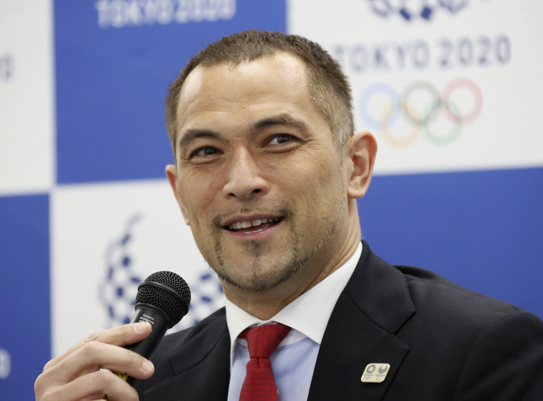 Tokyo 2020 Sports Director Koji Murofushi speaks during a press conference to unveil detailed Olympic competition schedule in Tokyo, Tuesday, April 16, 2019. For fans, athletes, and volunteers in Japan, next year's Olympics in Tokyo could become known as the get-up-early games.Organizers announced Tuesday that – hoping to beat summer heat in the Japanese capital – the men's 50-meter race walk final will begin at 5:30 a.m. The men's and women's marathon final will start at 6 a.m. (AP Photo/Koji Sasahara)