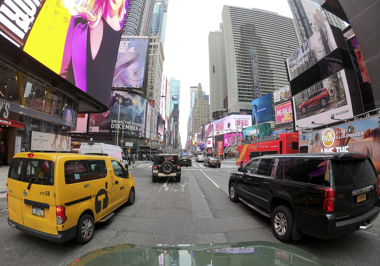 Motorists roll south on 7th Avenue in Times Square, Friday, March 29, 2019, in New York. A congestion toll that would charge drivers to enter New York City's central business district is a first for an American city. State legislators included it in the New York state budget that was approved Monday. (AP Photo/Julie Jacobson)