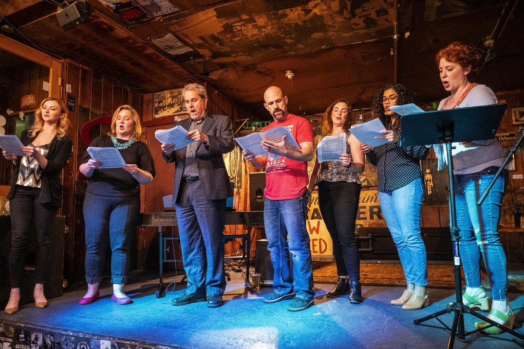 Members of Opera on Tap  (from left to right: Ksenia Popova, Kimberly Giordano, Charles Robert Stephens, Marcus Shelton, Kristin Vogel, Elizabeth Galafa and Melissa Plagemann) take the smallest of stages at the Blue Moon tavern in Seattle. (Dean Rutz / The Seattle Times)