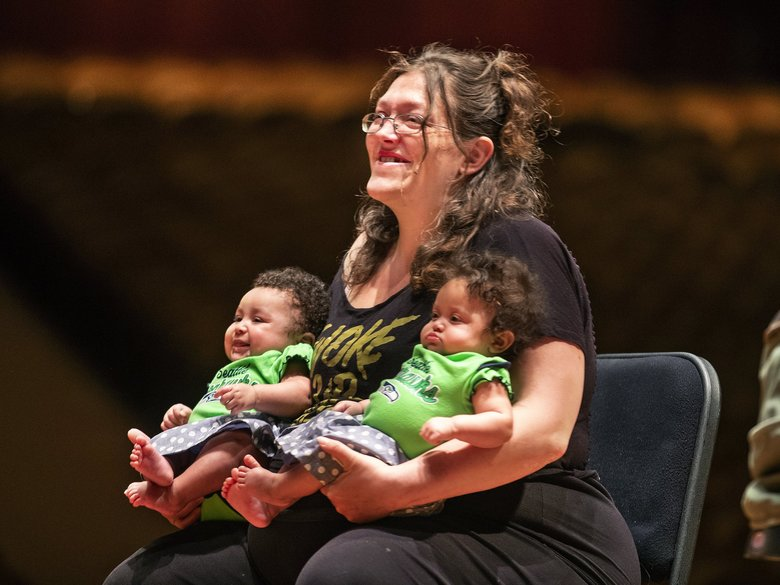Shawna Percival listens to the lullaby she wrote for her twins Vivian, left, and Jayden being performed by members of the Seattle Symphony. Percival, a client at Mary's Place, worked with a Seattle Symphony musician and a graduate student from Seattle Pacific University's music-therapy program to compose and record a lullaby for her children. (Mike Siegel / The Seattle Times)