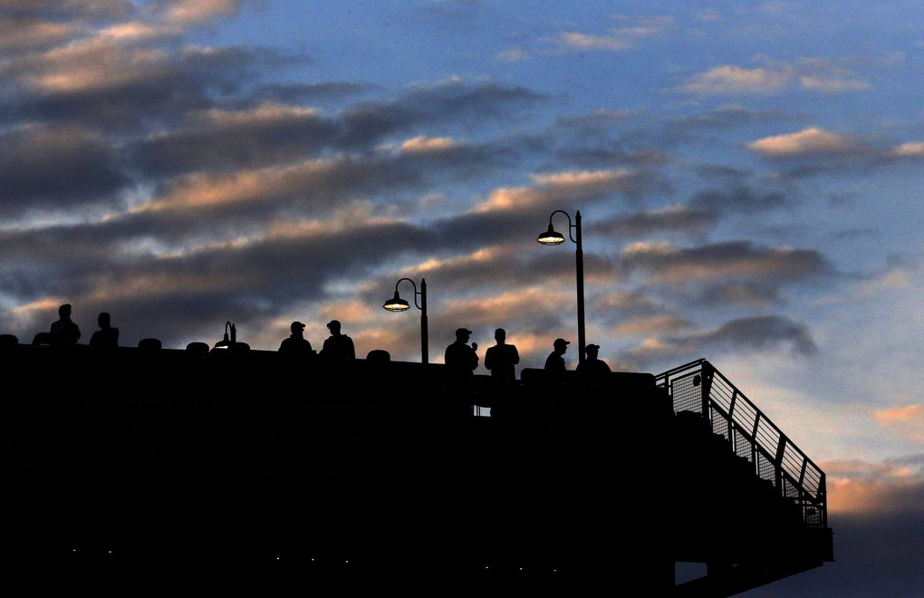 Fans watch the Mariners play Oakland at sundown, Monday, May 13, 2019 at T-Mobile Park in Seattle. (Ken Lambert / The Seattle Times)