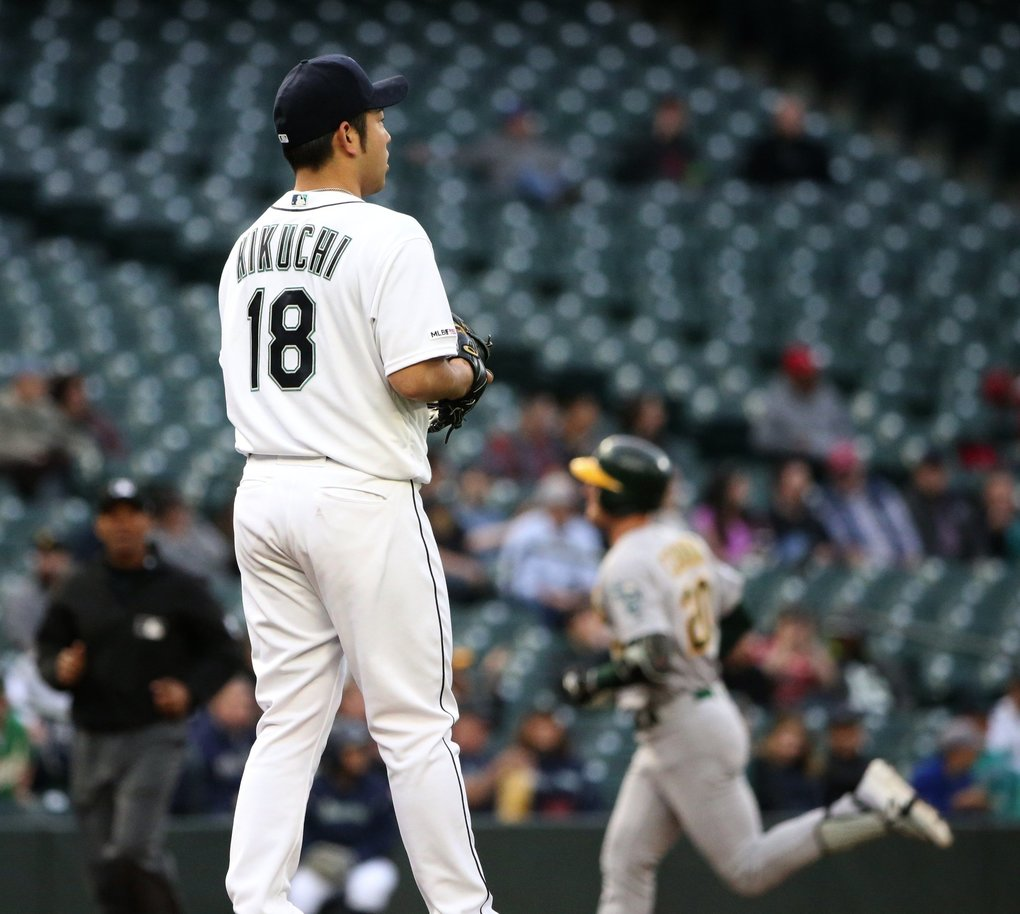 Mariners starting pitcher Yusei Kikuchi (18) gives up a homer to Oakland left fielder Mark Canha, in the second inning to tie up the game, Monday, May 13, 2019 at T-Mobile Park in Seattle. (Ken Lambert / The Seattle Times)