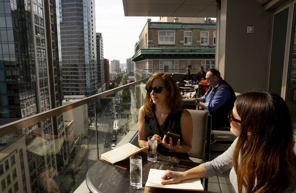 Susan Freuler, center, and Megan Souza scored prime seating at Seattle's new Fog Room. (Erika Schultz / The Seattle Times)