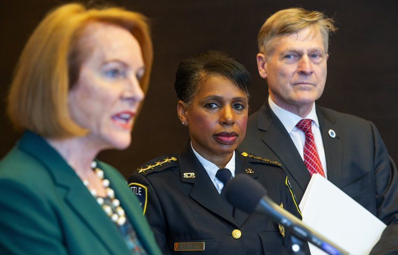 Mayor Jenny Durkan, left, Seattle Police Chief Carmen Best,  and City Attorney Pete Holmes address the media after a federal judge on Wednesday found that a portion of Seattle's contract with its biggest police union threatens to undermine public confidence in a seven-year-old reform agreement between the city and the Department of Justice.  Photographed on May 15, 2019. 210286
