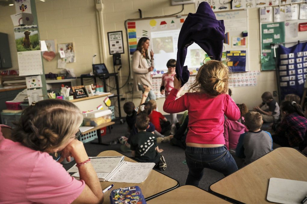 A young student unable to contain her energy is kept in the back of the classroom so as not to disturb the class at Woodland Heights School in Laconia, N.H.   (Cheryl Senter / Special to The Seattle Times)