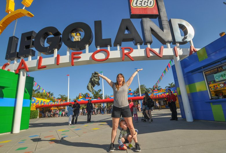 The author's wife and son in front of Legoland, a must-visit for 4-year-old Ian, who spends half his waking hours building Lego airplanes. (Jeff Layton / Special to The Seattle Times)