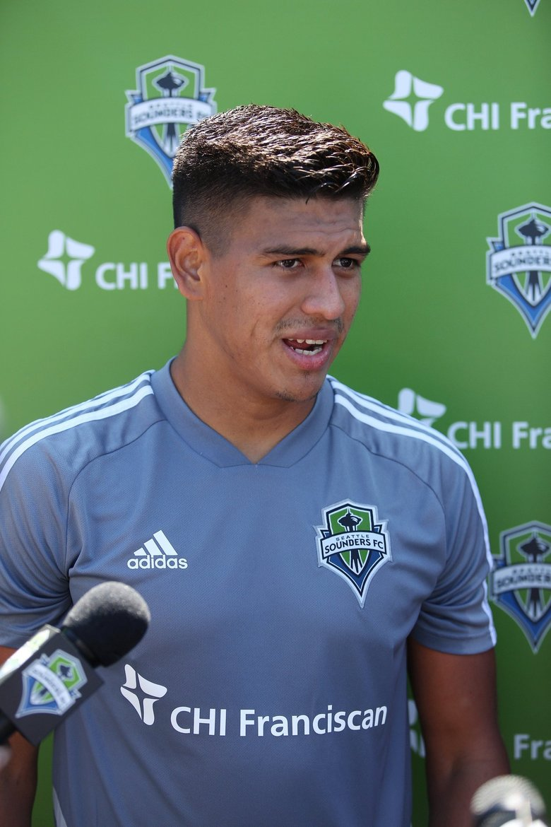 New Sounders defender Xavier Arreaga speaks with reporters after practice Thursday in Tukwila  (Mike Fiechtner / Sounders)