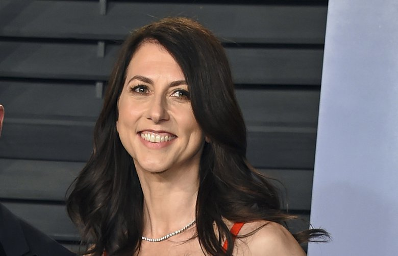 FILE – In this March 4, 2018 file photo, Jeff Bezos and wife MacKenzie Bezos arrive at the Vanity Fair Oscar Party in Beverly Hills, Calif. MacKenzie Bezos is pledging half her fortune to charity, following in the footsteps of billionaires Warren Buffett and Bill Gates. The ex-wife of Amazon founder and CEO Jeff Bezos finalized her divorce in April 2019 and reportedly got a stake in the online shopping giant worth over $35 billion. (Photo by Evan Agostini/Invision/AP, File) NYBZ251 NYBZ251