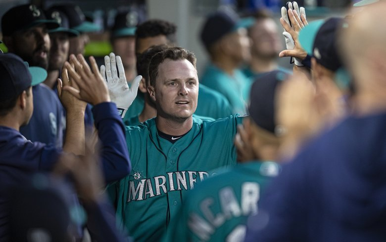 Seattle Mariners' Jay Bruce celebrates in the dugout after hitting a solo home run off Los Angeles Angels starting pitcher Tyler Skaggs during the seventh inning of a baseball game Friday, May 31, 2019, in Seattle. (Stephen Brashear / The Associated Press)