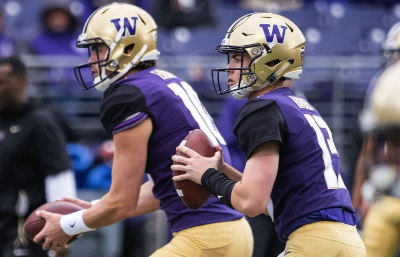 Washington quarterbacks Jake Haener, right, and Jacob Eason participate in the 2019 Spring Football Preview at Husky Stadium Saturday, April 27, 2019. (Dean Rutz / The Seattle Times)