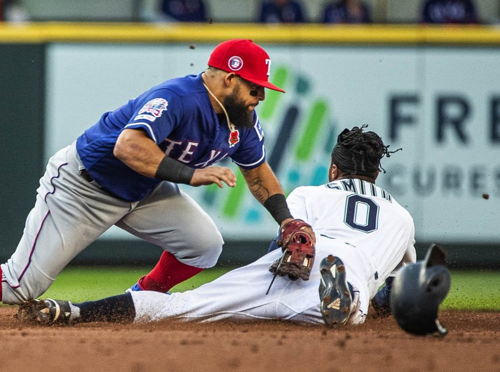 Seattle's Mallex Smith gets the stolen base in the 3rd, beating the tag from Texas' Rougned Odor.  The play was upheld on review.   (Dean Rutz / The Seattle Times)