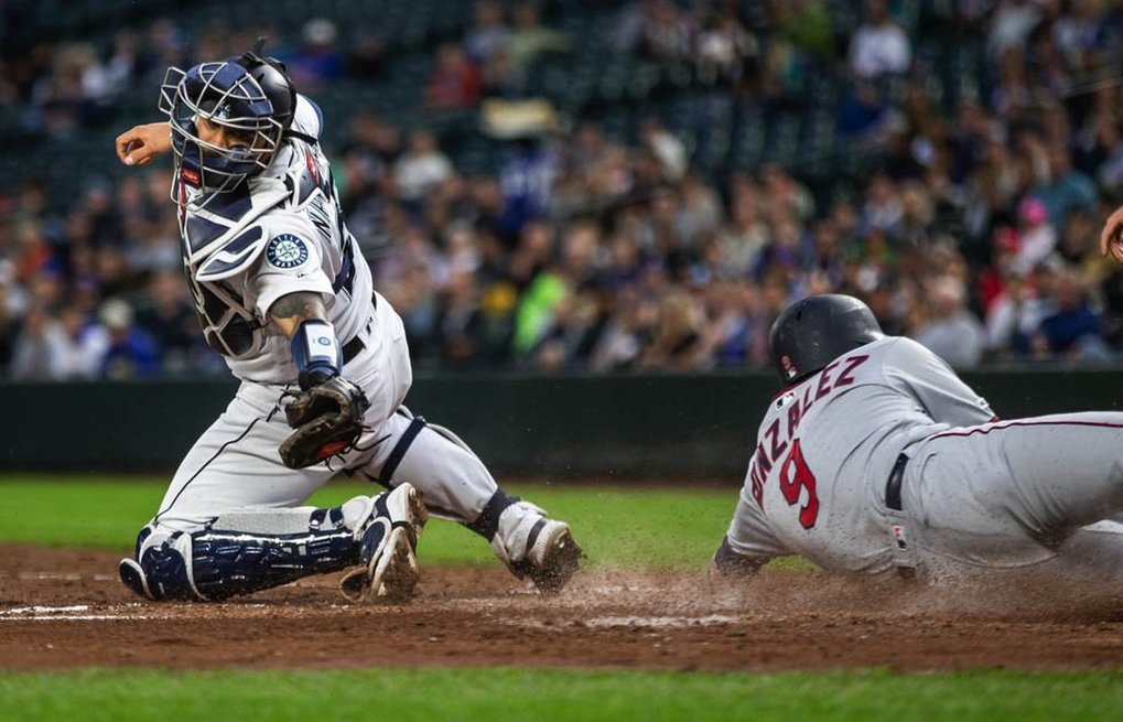 Seattle catcher Omar Narvaez reaches for the tag without the ball, and Minnesota's Marwin Gonzalez scores in the 4th inning.  The ball went wide on Narvaez on the throw from Edwin Encarnacion, who earned the error on the play.  The Minnesota Twins played the Seattle Mariners Thursday, May 16, 2019 at T-Mobile Park in Seattle, WA. 210257 (Dean Rutz / The Seattle Times)