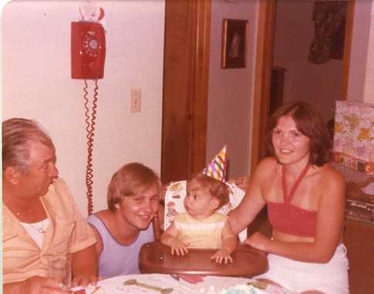 Ben Hopper celebrates his first birthday with his parents, Paul and Julia, and his grandfather Ennio Guglielmi, in Paul and Julia Hopper's first house, a rental in Lackawanna, New York, in August 1977. (Courtesy Ben Hopper)