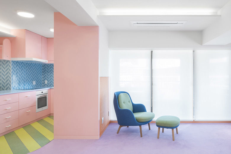 A three-bedroom apartment in Tokyo's Nagatacho district that was renovated by British architectural designer Adam Nathaniel Furman. Working with ceilings under 8 feet, Furman used the contrast of bold pastels and white ceilings to accentuate the perception of height. (Jan Vranovsky via The New York Times)