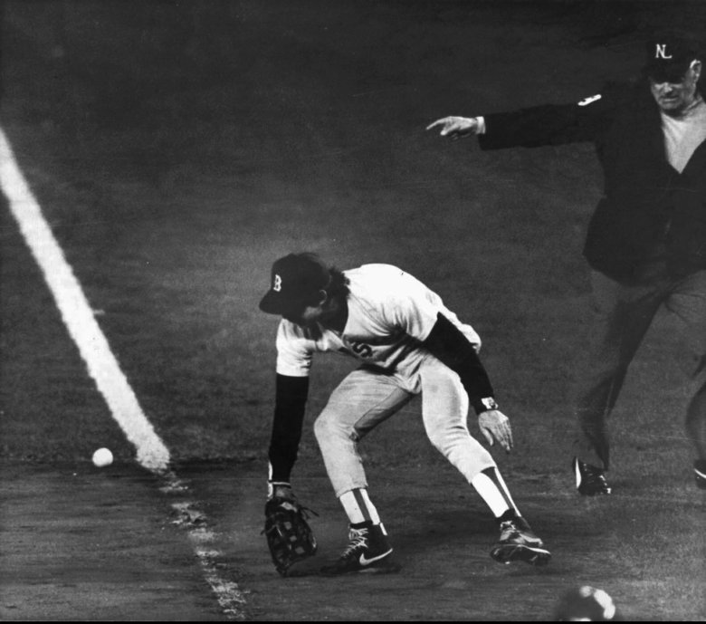 FILE – In this Oct. 25, 1986, file photo, Boston Red Sox first baseman Bill Buckner misplays the ball during during Game 6 of the World Series against the New York Mets. Buckner, a star hitter who became known for making one of the most infamous plays in major league history, has died. He was 69. Buckner's family said in a statement that he died Monday, May 27, 2019, after a long battle with dementia. (Stan Grossfeld/The Boston Globe via AP, File)
