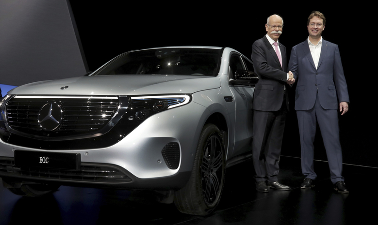 Daimler CEO Dieter Zetsche, left, and incoming Daimler CEO Ola Kaellenius, right, pose prior to the annual shareholder meeting of the car manufacturer Daimler in Berlin, Germany, Wednesday, May 22, 2019. (AP Photo/Michael Sohn)