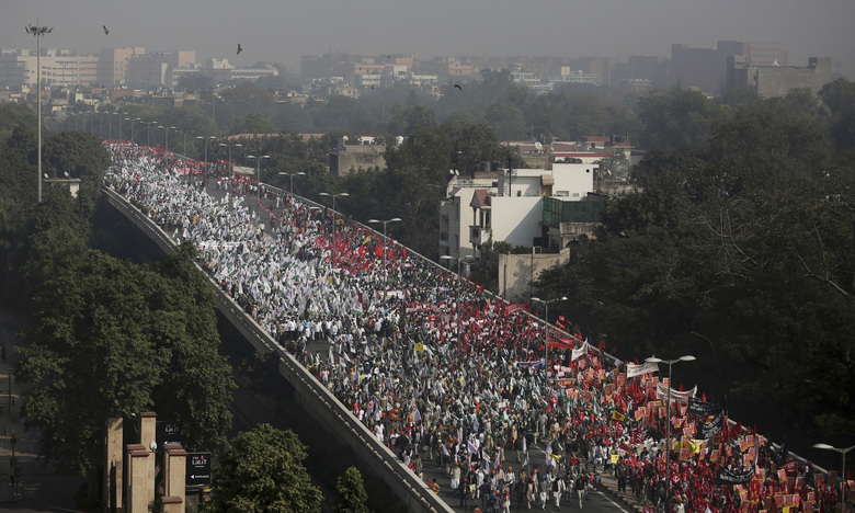 FILE – In this Friday, Nov. 30, 2018 file photo, Indian farmers and agricultural laborers march towards the Indian Parliament during a protest rally in New Delhi, India. India's slowing economy appears not to have deterred millions of voters from supporting Prime Minister Narendra Modi and his Hindu nationalist party's return to power. Final curtain fell down on Friday, May 24, 2019, on the marathon Indian parliament election that gave a second term for Prime Minister Narendra Modi, despite his government's flawed economic performance and his Hindu nationalist party's divisive rhetoric. (AP Photo/Altaf Qadri)