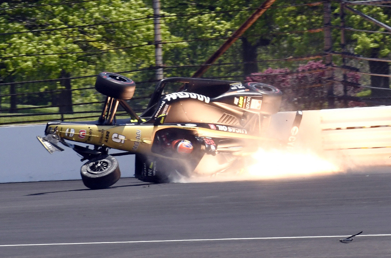 James Hinchcliffe, of Canada, slides into the backstretch after hitting the wall along the second turn during qualifications for the Indianapolis 500 IndyCar auto race at Indianapolis Motor Speedway, Saturday, May 18, 2019, in Indianapolis. (AP Photo/Greg Huey)