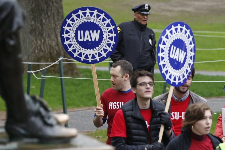 Union protesters march at Harvard University in Cambridge, Mass., Wednesday, May 1, 2019. Students plan campus-wide protests on Wednesday over what organizers say are increasing incidents of harassment and discrimination.(AP Photo/Michael Dwyer)