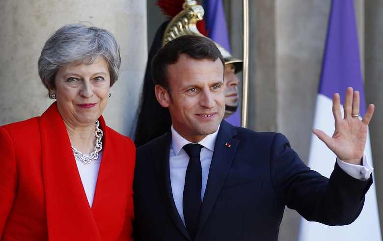 French President Emmanuel Macron, right, greets British Prime Minister Theresa May at the Elysee Palace, in Paris, Wednesday, May 15, 2019. Several world leaders and tech bosses are meeting in Paris to find ways to stop acts of violent extremism from being shown online.(AP Photo/Francois Mori)