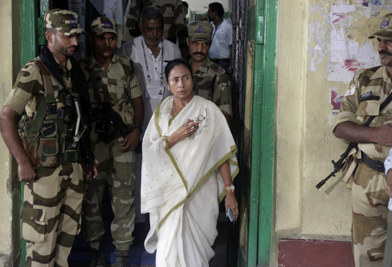 Trinamool Congress party leader and Chief Minister of West Bengal state Mamata Banerjee gestures as she comes out after casting her vote at a polling station during the final phase of national elections in Kolkata , India, Sunday, May 19, 2019. Indians voted in the seventh and final phase of national elections Sunday, wrapping up a 6-week-long grueling campaign season with Prime Minister Narendra Modi's Hindu nationalist party seeking reelection for another five years. (AP Photo/Bikas Das)