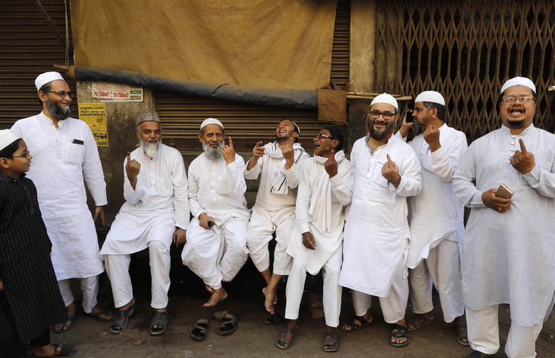 Indian Muslims display indelible ink mark on their fingers after casting their votes outside a polling station in Varanasi, India,Sunday, May 19, 2019. Indians are voting in the seventh and final phase of national elections, wrapping up a 6-week-long long, grueling campaign season with Prime Minister Narendra Modi's Hindu nationalist party seeking reelection for another five years. Counting of votes is scheduled for May 23. (AP Photo/Rajesh Kumar Singh)