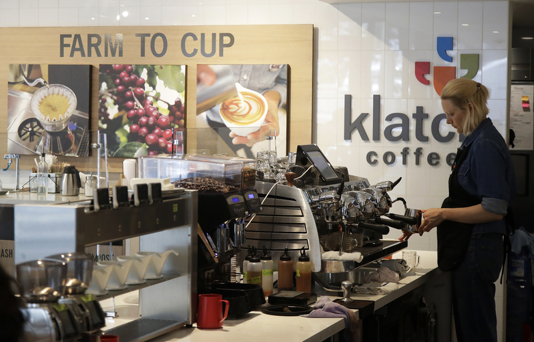 """A barista prepares an order at Klatch Coffee in San Francisco, Wednesday, May 15, 2019. The California cafe is brewing up what it calls the world's most expensive coffee – at $75 a cup. A few lucky coffee lovers got to try free samples Wednesday at the San Francisco branch, where promotional signs are on display advertising, """"World's Most Expensive Coffee."""" (AP Photo/Jeff Chiu)"""