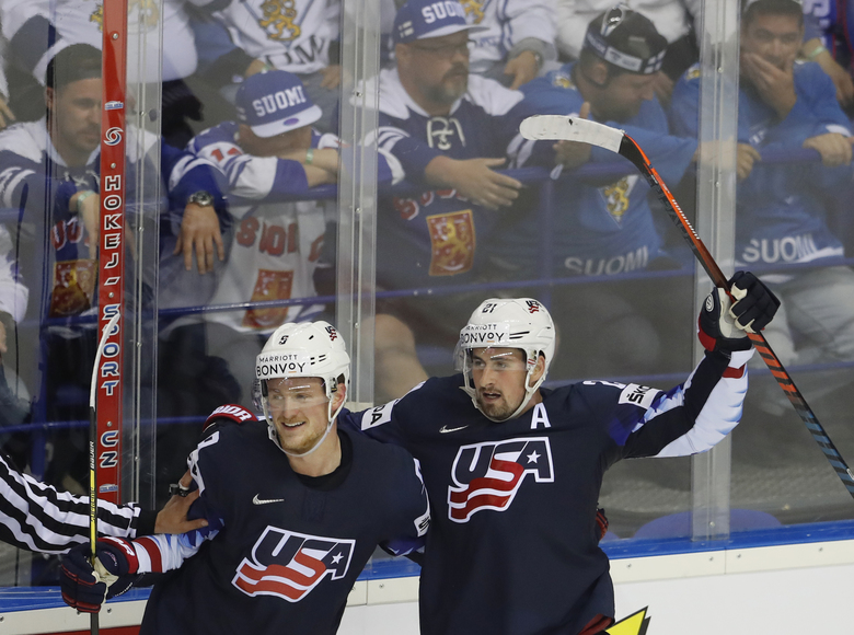 Dylan Larkin of the US, right, celebrates with Jack Eichel of the US, left, after scoring his sides winning goal during the Ice Hockey World Championships group A match between the United States and Finland at the Steel Arena in Kosice, Slovakia, Monday, May 13, 2019. (AP Photo/Petr David Josek)