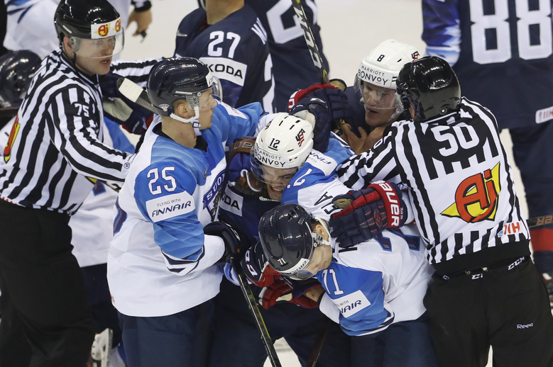 Referees break off a fight during the Ice Hockey World Championships group A match between the United States and Finland at the Steel Arena in Kosice, Slovakia, Monday, May 13, 2019. (AP Photo/Petr David Josek)