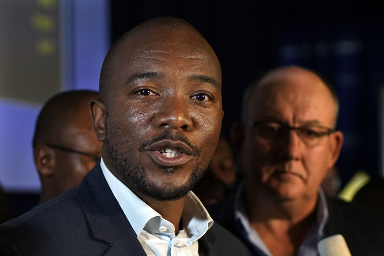Mmusi Maimane, leader of the largest opposition party, the Democratic Alliance, speaks to the media as he visits the Independent Electoral Commission Results Center in Pretoria, South Africa Friday, May 10, 2019. The ruling African National Congress held a comfortable lead in South Africa's presidential and parliamentary election with more than two-thirds of the vote counted Thursday, but the incomplete count showed the party received less support than in the last balloting five years ago. (AP Photo/Jerome Delay)