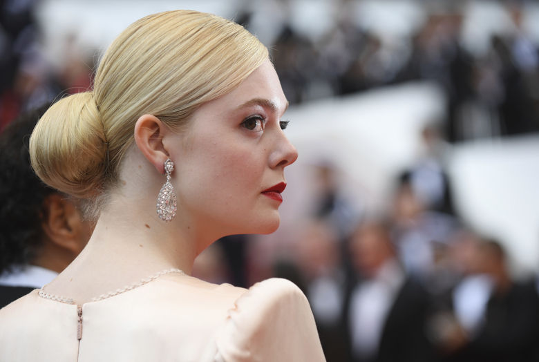 Jury member Elle Fanning poses for photographers upon arrival at the opening ceremony and the premiere of the film 'The Dead Don't Die' at the 72nd international film festival, Cannes, southern France, Tuesday, May 14, 2019. (Photo by Arthur Mola/Invision/AP)
