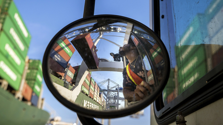 FILE – In this June, 19, 2018 photo, a jockey truck driver waits for his load of a shipping container to clear his trailer as a shore crane lifts the 40-foot onto the container vessel Ever Linking at the Port of Savannah in Savannah, Ga. President Donald Trump turned up the pressure on China Sunday, May 5, 2019, threatening to hike tariffs on $200 billion worth of Chinese goods. (AP Photo/Stephen B. Morton, File)