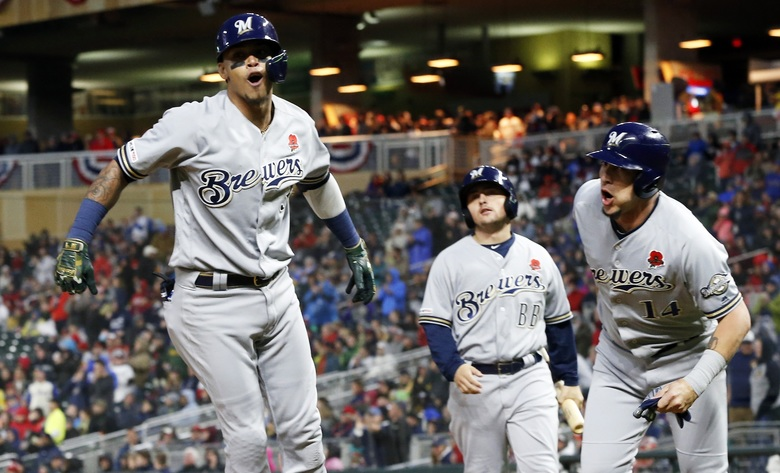Milwaukee Brewers' Orlando Arcia, left, and Hernan Perez, right, celebrate Arcia's two-run home run off Minnesota Twins pitcher Taylor Rogers in the eighth inning of a baseball game Monday, May 27, 2019, in Minneapolis. The Brewers won 5-4. (AP Photo/Jim Mone)