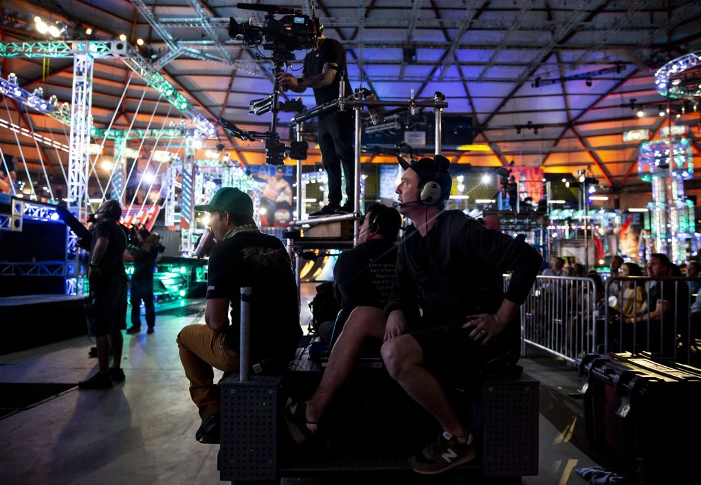 """American Ninja Warrior"" associate director Dave Massey, center, watches the competition at the Tacoma Dome last month. (Erika Schultz / The Seattle Times)"