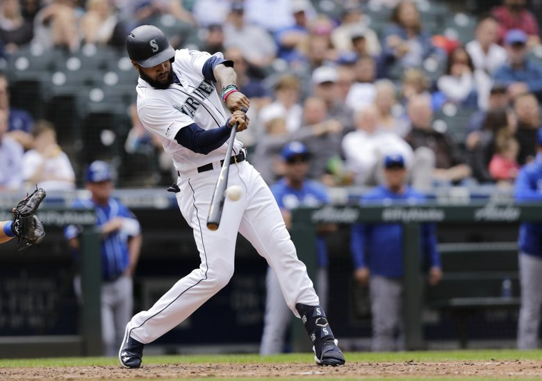 Seattle Mariners' Domingo Santana hits an RBI single against the Kansas City Royals during the fourth inning of a baseball game Wednesday, June 19, 2019, in Seattle. (John Froschauer / The Associated Press)