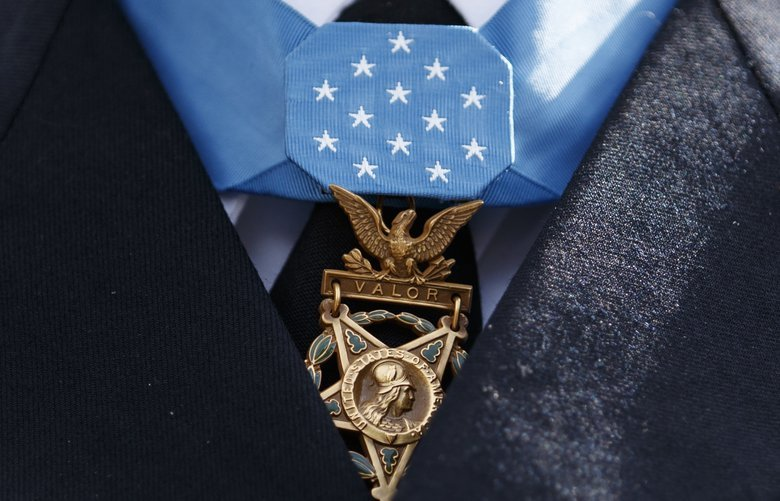 The Medal of Honor hangs around the neck of Medal of Honor recipient Army Staff Sgt. David Bellavia is seen as he speaks to media outside the West Wing of the White House in Washington, Tuesday, June 25, 2019, after receiving the Medal of Honor from President Donald Trump for conspicuous gallantry while serving in support of Operation Phantom Fury in Fallujah, Iraq. (AP Photo/Carolyn Kaster) DCCK113 DCCK113