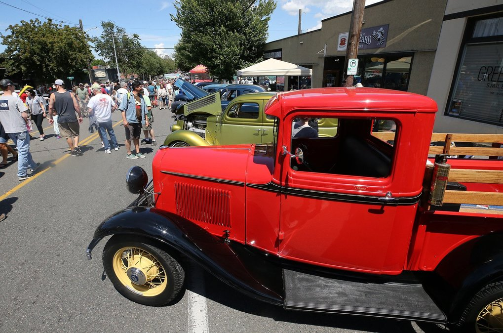 At right is Dave Ellis' totally restored 1932 Ford pickup with stock 80 horsepower V8 engine.  (Greg Gilbert / The Seattle Times)